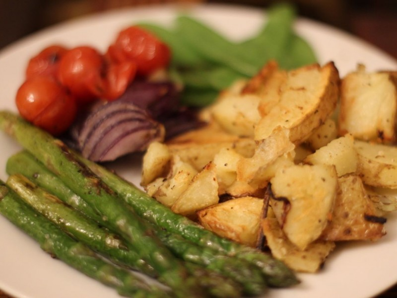 Garlic roasted potatoes, with Pan fried asparagus, cherry tomatoes, red onions and mangetout